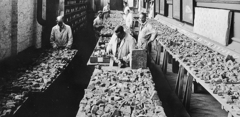 Hundreds of thousands of glazed brick fragments being sorted in the colonnades of the Neues Museum, Berlin, 1927–1928