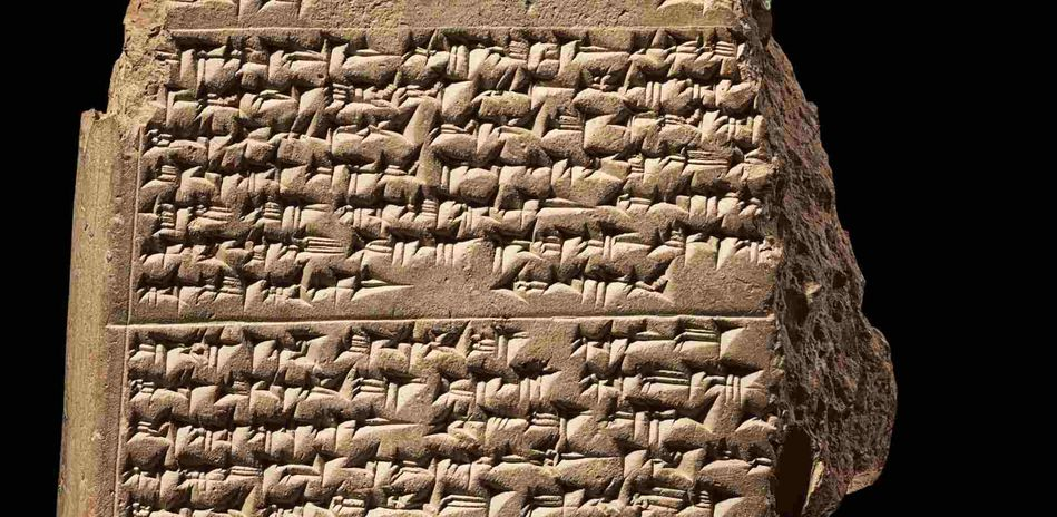 Cuneiform tablet with the Epic of Gilgamesh from Mesopotamia, detail. Burnt Clay with Cuneiform Inscription in Akkadian, 13th Century BCE, Royal Palace of Hattusha, Bogazköy, Anatolia