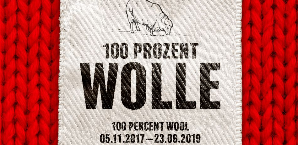 "On view is the label of the exhibition ""100 Percent Wool"""