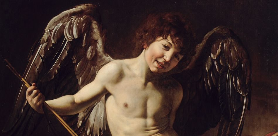 The picture shows a smiling naked boy with wings in a provocative pose.