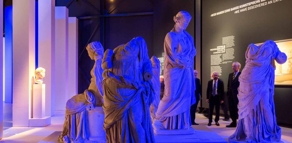 Draped statues in changing light
