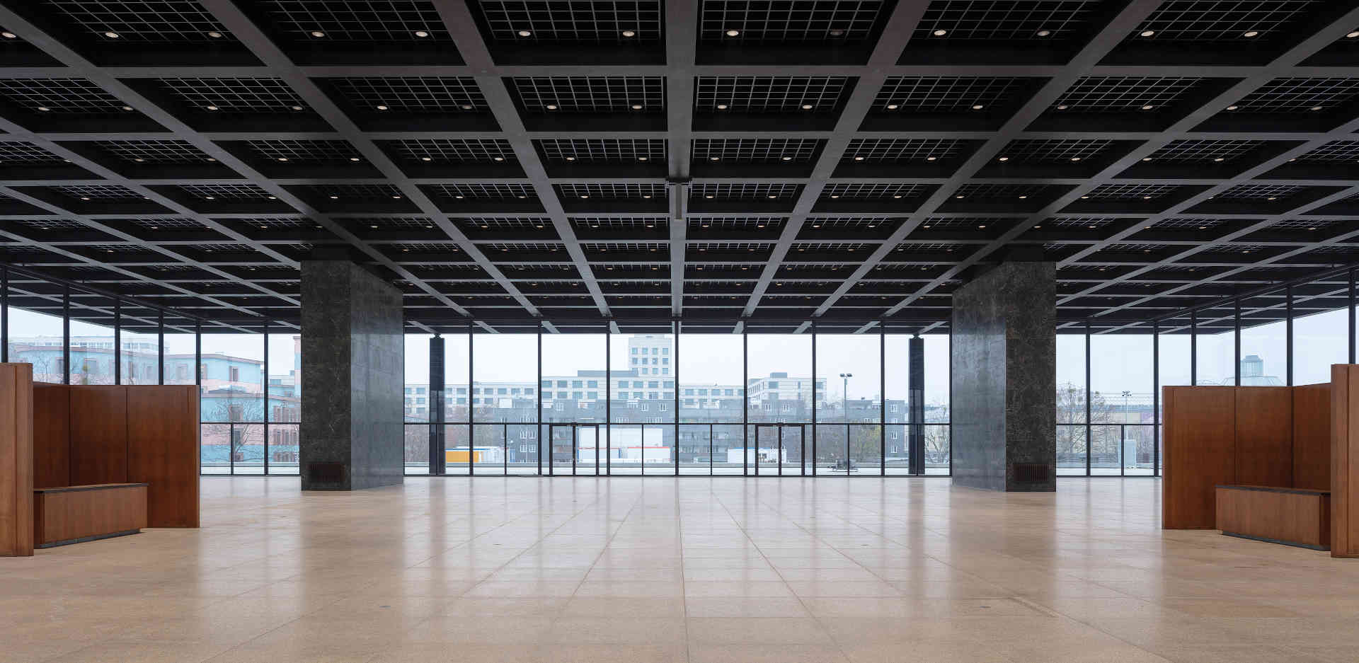 The original construction elements, such as the ceiling grids and stone panels in the Neue Nationalgalerie's upper exhibition hall, have been carefully restored.